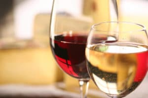 Red and White wine in clear stemmed glasses