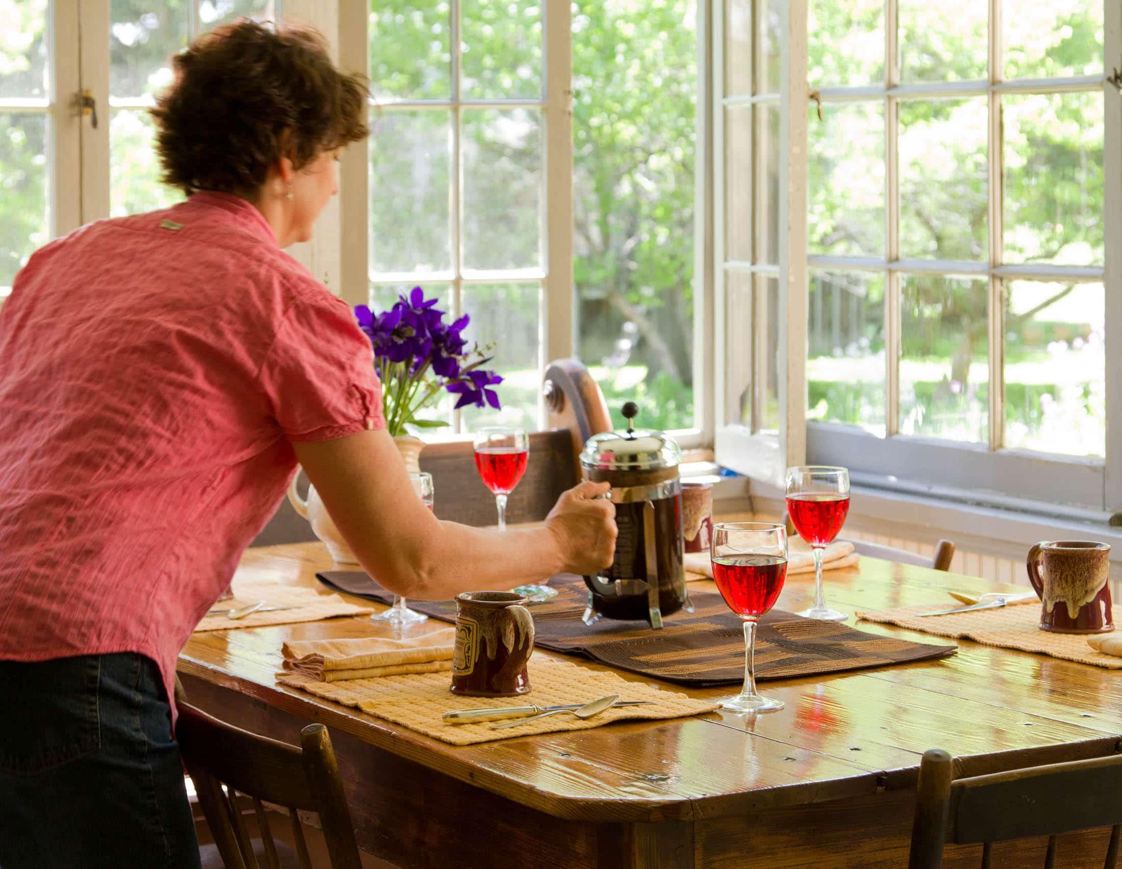 Rose the Innkeeper serving breakfast