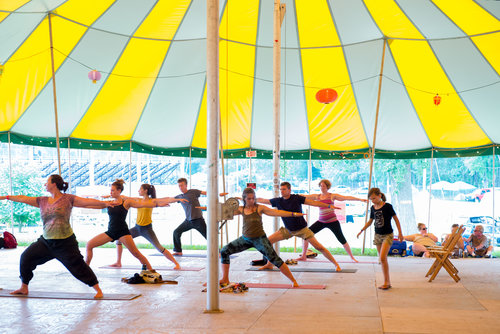 Yoga under the dance tent at Grassroots Culture Camp